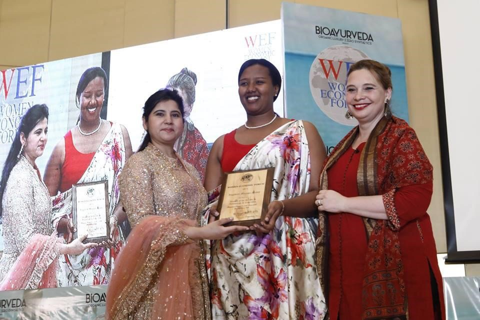 "The Managing Director, Ingabire Muziga Mamy receives the 2019 WEF award ""Women of the decade in Innovation and Leadership"" presented by Dr. Harbeen Arora, Chairperson of Women Economic Forum and ALL Ladies League"